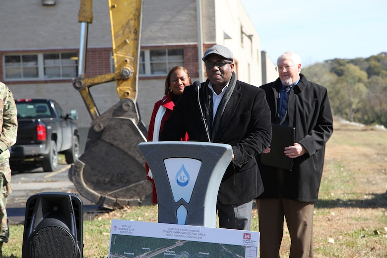 The speakers at the ceremony November 1, 2019, broke the ground at Swope Park Industrial Area. At the podium, Councilman Lee Barnes, representing the 5th Council District, delivered remarks emphasizing the most credit should go to the people and business who occupy the Swope Park Industrial Area as they have suffered the most and worked hard for the positive changes the longest.