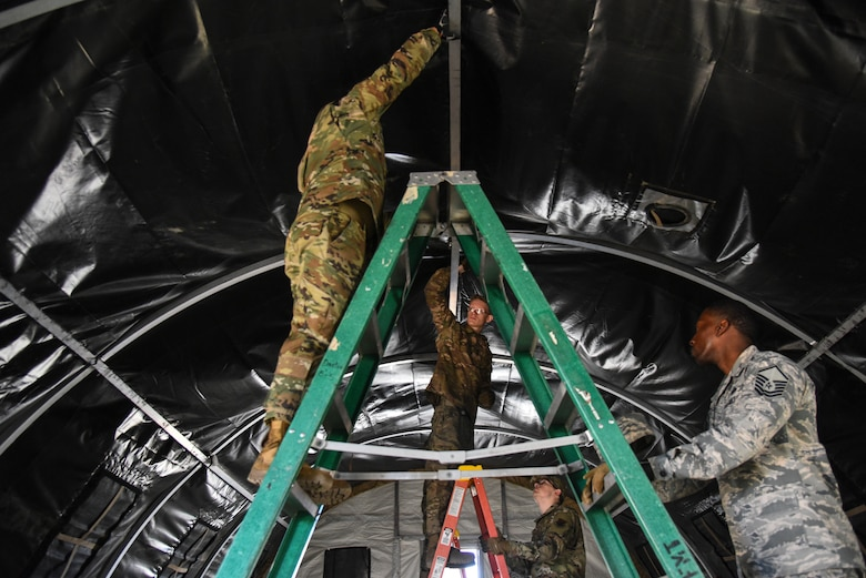 U.S. Airmen assigned to the 355th Wing deconstruct a tent during Exercise Bushwhacker 19-08 at Davis-Monthan Air Force Base, Arizona, Oct. 30, 2019. One of DM's focuses is to ensure all Airmen deploying out of Davis-Monthan to a forward operating location are multi-functional Airmen – executing their individual trades, while also being able to perform functions outside of their Air Force Specialty Codes. (U.S. Air Force photo by Senior Airman Mya M. Crosby)