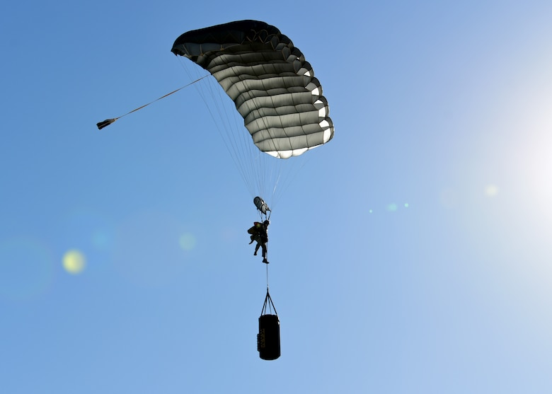 a photo of an airman parachuting with a barrel of socks