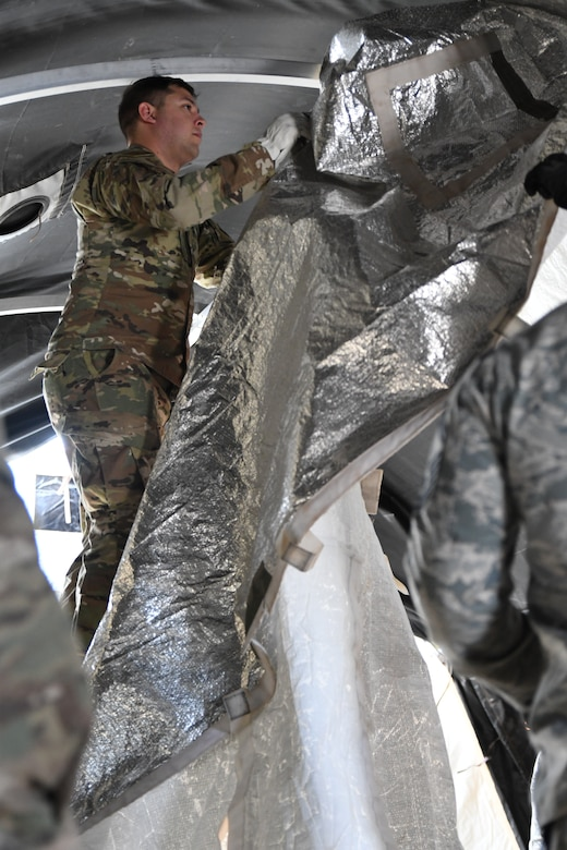 a photo of airmen learning how to build tents