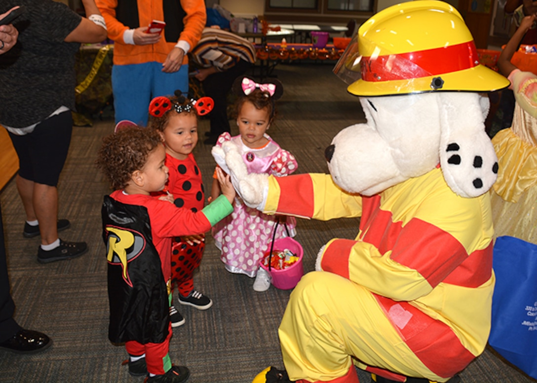 Sparky hi-fives children at Halloween event