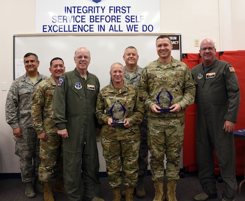 Lt. Col. Tiffiny Strever, 161st MDG Chief Nurse and Capt. James Taylor, 161st MDG medical readiness officer were presented awards from the Air National Guard Medical Service Annual Awards program at Goldwater Air National Guard Base, Phoenix, Nov. 2, 2019. (U.S. Air National Guard photo by Tech. Sgt. Michael Matkin)