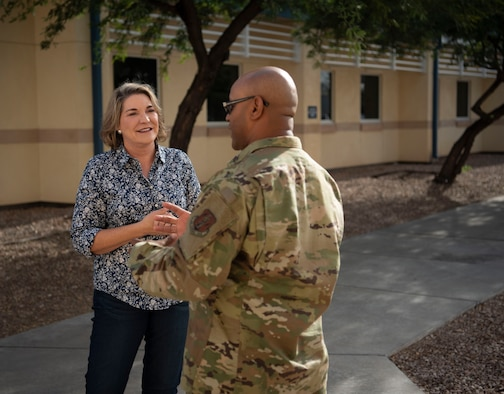 Darci Thompson, the 162nd Wing's Director of Psychological Health, takes a moment to speak with an Airman during drill at Morris Air National Guard Base in Tucson, Ariz.
