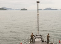 PHUKET, Thailand (Nov. 3, 2019) Marines, from 2nd Battalion, 2nd Marine Regiment, currently assigned to 3rd Marine Division, stand watch on the forecastle, as the Whidbey Island-class dock landing ship USS Germantown (LSD 42) prepares to anchor near Phuket, Thailand.  Germantown, part of Commander, Amphibious Squadron 11, is deployed to the Indo-Pacific region to enhance interoperability with partners and serve as a ready-response force for any type of contingency.