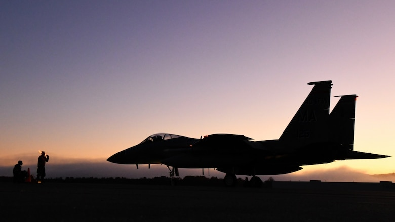 U.S. Air Force Airmen, assigned to the 104th Fighter Wing, Massachusetts Air National Guard, prepare an F-15 Eagle for take off during a four-day readiness exercise at Barnes Air National Guard Base, Mass, Nov. 2, 2019,. (U.S. Air National Guard photo by Airman 1st Class Sara Kolinski)
