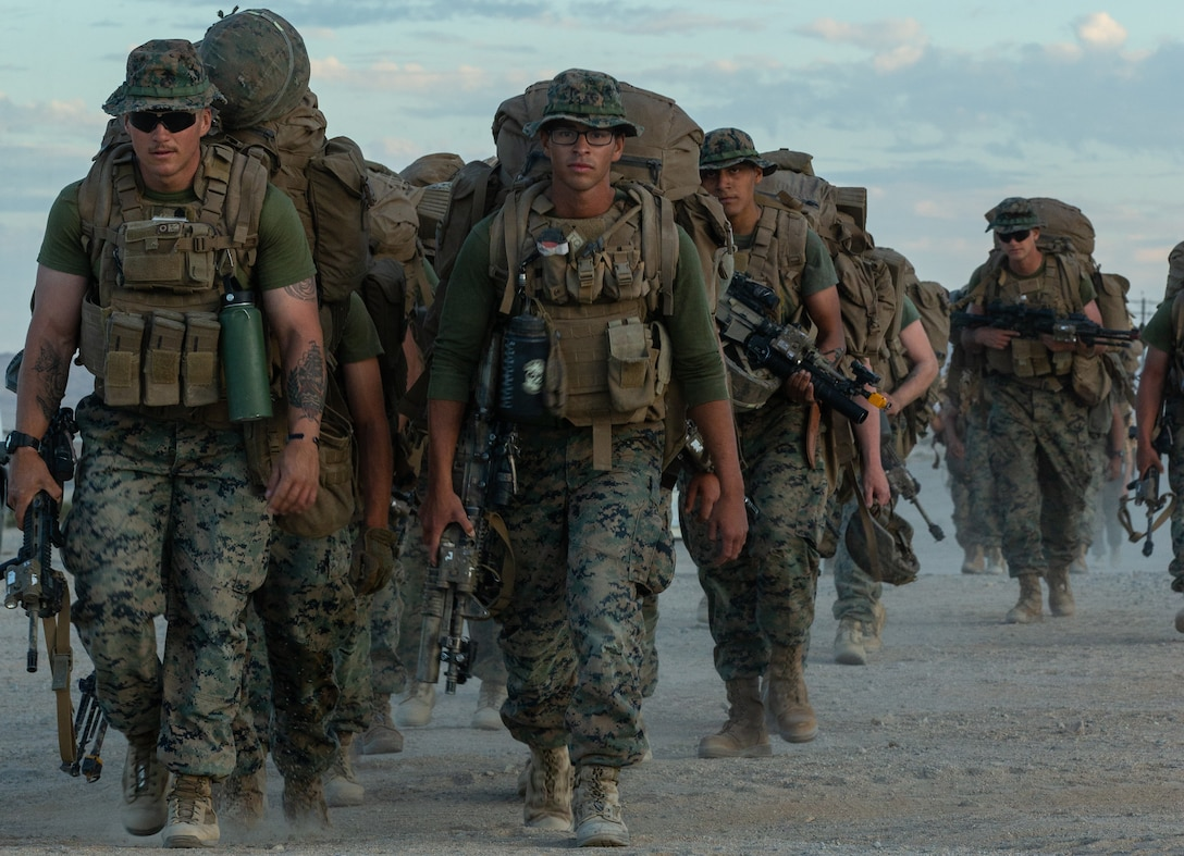U.S. Marines with 7th Marine Regiment, 1st Marine Division conduct a hike on Camp Wilson, Marine Corps Air Ground Combat Center, Twentynine Palms, California, Nov. 2, 2019.  The regiment is participating as the adversary force in the execution of the MAGTF Warfighting Exercise 1-20. MWX is the largest unscripted, force-on-force, exercise conducted by the 2nd Marine Division in several decades.