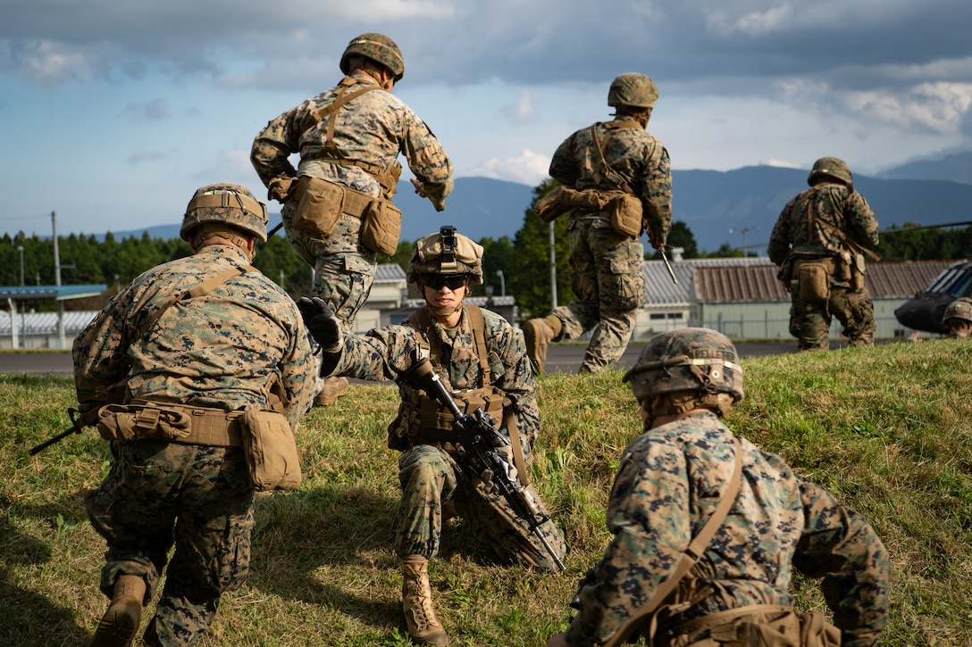 U.S. Marine Staff Sgt. Thomas R. Sterett takes accountability of Marines boarding U.S. Army Sikorsky UH-60 Black Hawks during Black Hawk integration training as part of exercise Fuji Viper 20-1 on Camp Fuji, Japan, Oct. 28, 2019. Fuji Viper is a regularly scheduled training evolution for infantry units assigned to 3rd Marine Division as part of the unit deployment program. The training allows units to maintain their lethality and proficiency in infantry and combined arms tactics. Sterett is assigned to 4th Marine Regiment, 3rd Marine Division, and a native of Town Falls, Idaho.