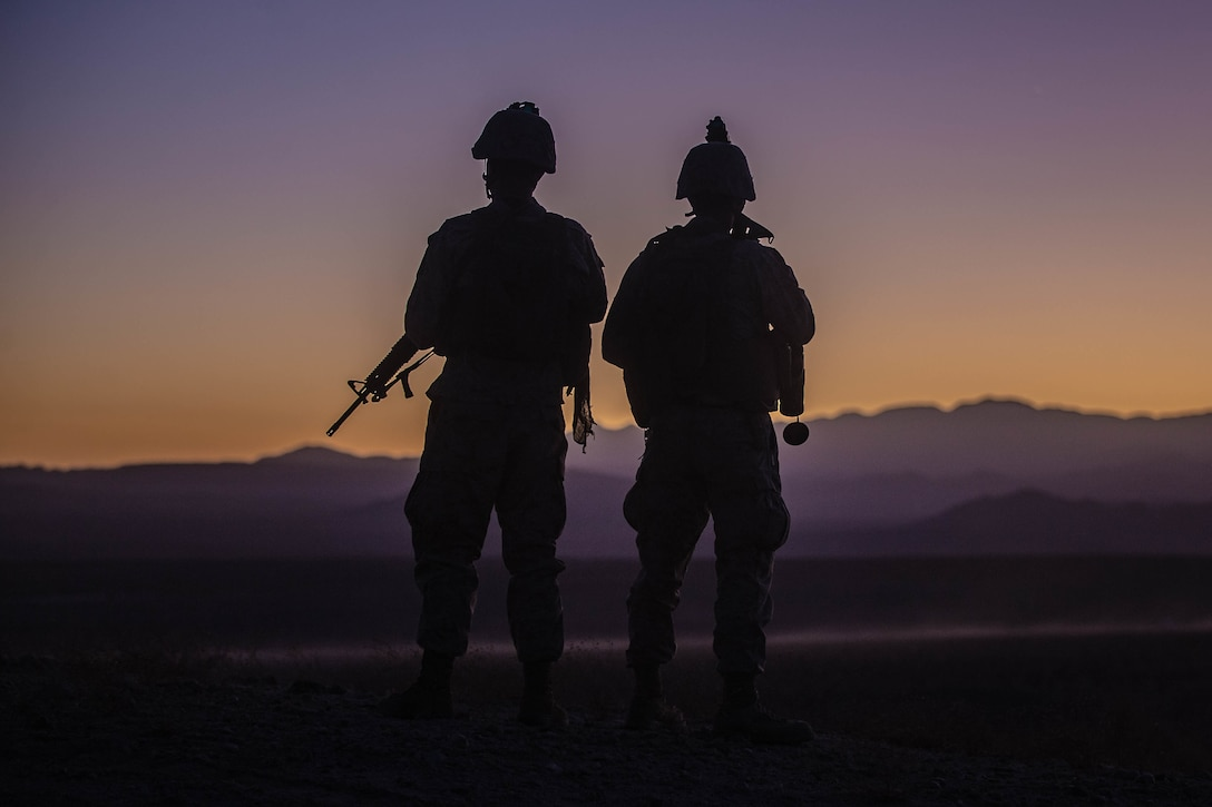 U.S. Marine Corps Staff Sgt. William Huffman, left and Cpl. Stephen Gibbons with Combat Logistics Battalion 8, Combat Logistics Regiment 2, 2nd Marine Logistics Group, prepare to depart an observation point during Integrated Training Exercise 1-20 at Marine Air Ground Combat Center Twentynine Palms, California, Oct. 28, 2019. CLB-8 integrated with 2nd Marine Regiment during ITX as the logistics combat element to provided tactical logistics in the areas of medium and heavy-lift motor transportation beyond the regiment's organic capabilities.