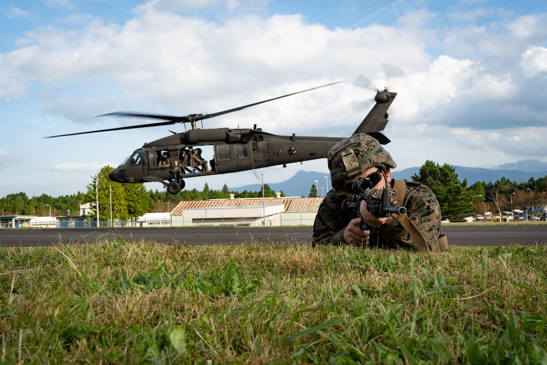 U.S. Marine Lance Cpl. Dakota Gosa provides security during Black Hawk integration training as part of exercise Fuji Viper 20-1 on Camp Fuji, Japan, Oct. 28, 2019. Fuji Viper is a regularly scheduled training evolution for infantry units assigned to 3rd Marine Division as part of the unit deployment program. The training allows units to maintain their lethality and proficiency in infantry and combined arms tactics. Gosa is assigned 4th Marine Regiment, 3rd Marine Division, and a native of Greenville, S.C.