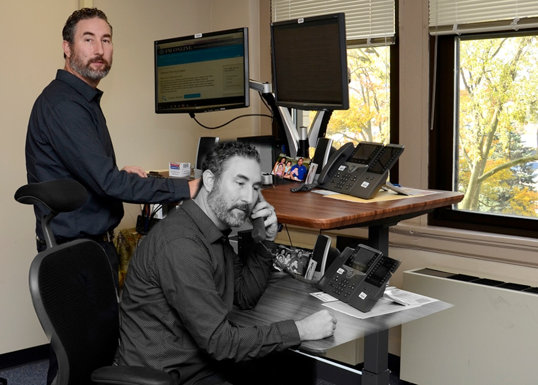 DLA Disposition Services Finance Director Isaac Stanley received his first sit-stand desk in June and said the work space flexibility has improved his posture and lessened back pain. Photo illustration.