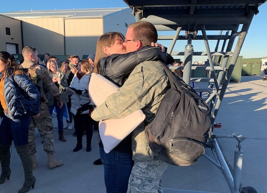 Tech. Sgt. Logan Everton embraces girlfriend, Kyleah Adamson, upon arriving home following a six-month deployment to Al Dhafra Air Base, United Arab Emirates.