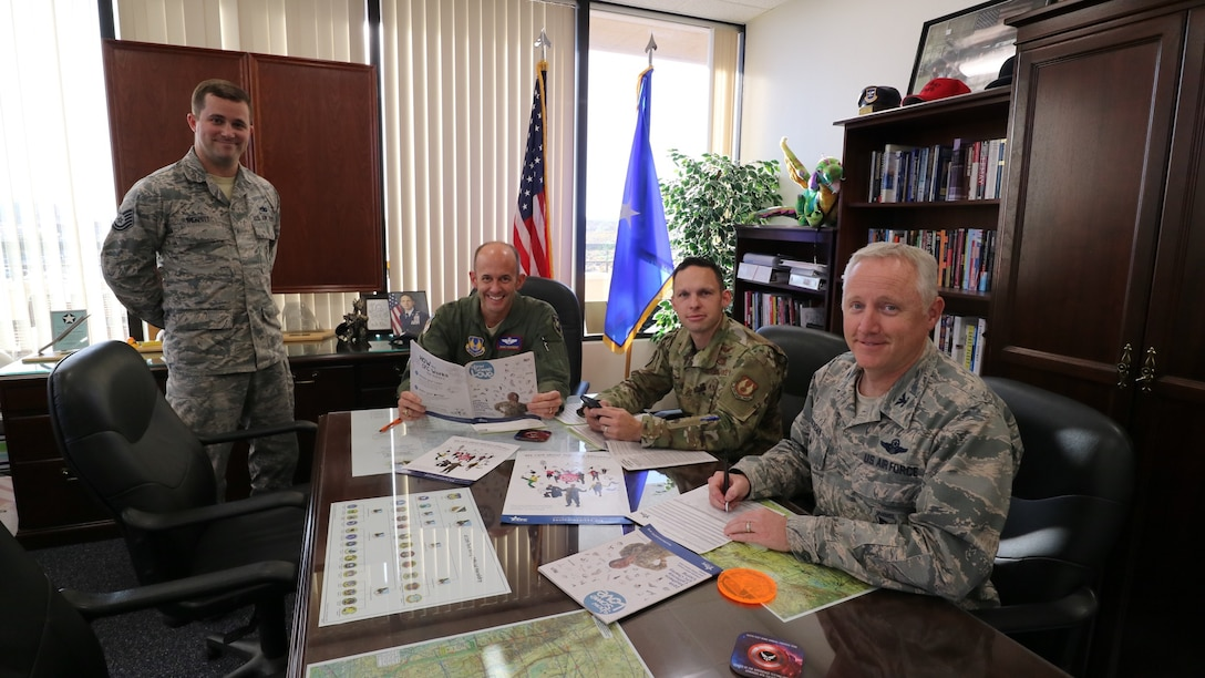 Tech. Sgt. Kenneth Merritt, 412th Aircraft Maintenance SquadronBrig. Gen. E. John Teichert, 412th Test Wing Commander, Chief Master Sgt. Ian Eishen, 412th TW Command Chief, and Col. Kirk Reagan, 412th TW Vice Commander, kicked off this year's Combined Federal Campaign at wing headquarters on Edwards Air Force Base, California, Nov. 4.