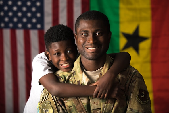 U.S. Air Force Senior Airman Akwasi Agyeman-Prempeh, 56th Force Support Squadron storeroom apprentice, and his son Kofi pose for a photo Oct. 23, 2019 at Luke Air Force Base, Ariz.