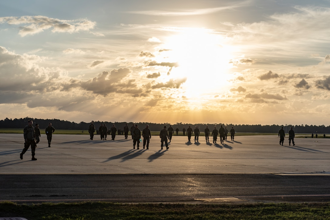 A photo of Airmen gathering for a foreign object debris walk across the airfield