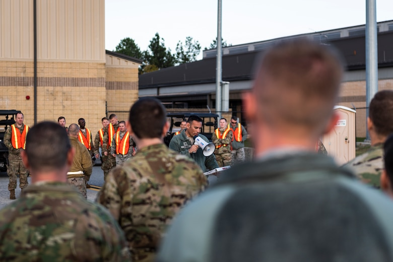 Col. Ben Conde, 23d Wing vice commander, briefs Airmen before a foreign object debris (FOD) walk Nov. 4, 2019, at Moody Air Force Base, Ga. FOD is considered to be any foreign substance that could potentially cause damage to an aircraft. After the 2019 Thunder Over South Georgia Open House, Airmen with the 23d Wing conducted a FOD walk across the airfield to ensure safe operations for Moody's aircraft. (U.S. Air Force photo by Airman 1st Class Hayden Legg)