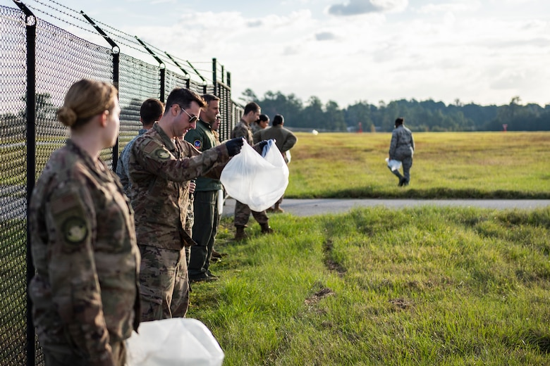 Airmen assigned to the 23d Wing prepare for a foreign object debris (FOD) walk Nov. 4, 2019, at Moody Air Force Base, Ga. FOD is considered to be any foreign substance that could potentially cause damage to an aircraft. After the 2019 Thunder Over South Georgia Open House, Airmen with the 23d Wing conducted a FOD walk across the airfield to ensure safe operations for Moody's aircraft. (U.S. Air Force photo by Airman 1st Class Hayden Legg)