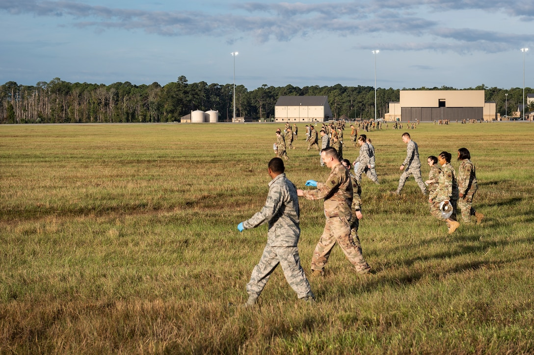 A photo of Airmen conducting a foreign object debris walk across the airfield