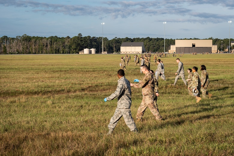 Airmen assigned to the 23d Wing conduct a foreign object debris (FOD) walk Nov. 4, 2019, at Moody Air Force Base, Ga. FOD is considered to be any foreign substance that could potentially cause damage to an aircraft. After the 2019 Thunder Over South Georgia Open House, Airmen with the 23d Wing conducted a FOD walk across the airfield to ensure safe operations for Moody's aircraft. (U.S. Air Force photo by Airman 1st Class Hayden Legg)
