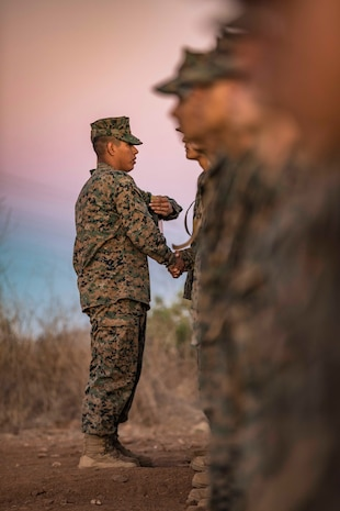 San Diego, California – Sergeant. Hector Lomeli a Senior Drill Instructor with Echo Company Platoon 2115, 2nd Recruit Training Battalion, gives the Eagle, Globe to his Marines after completing the Crucible at Marine Corps Base Camp Pendleton, California Oct. 24.