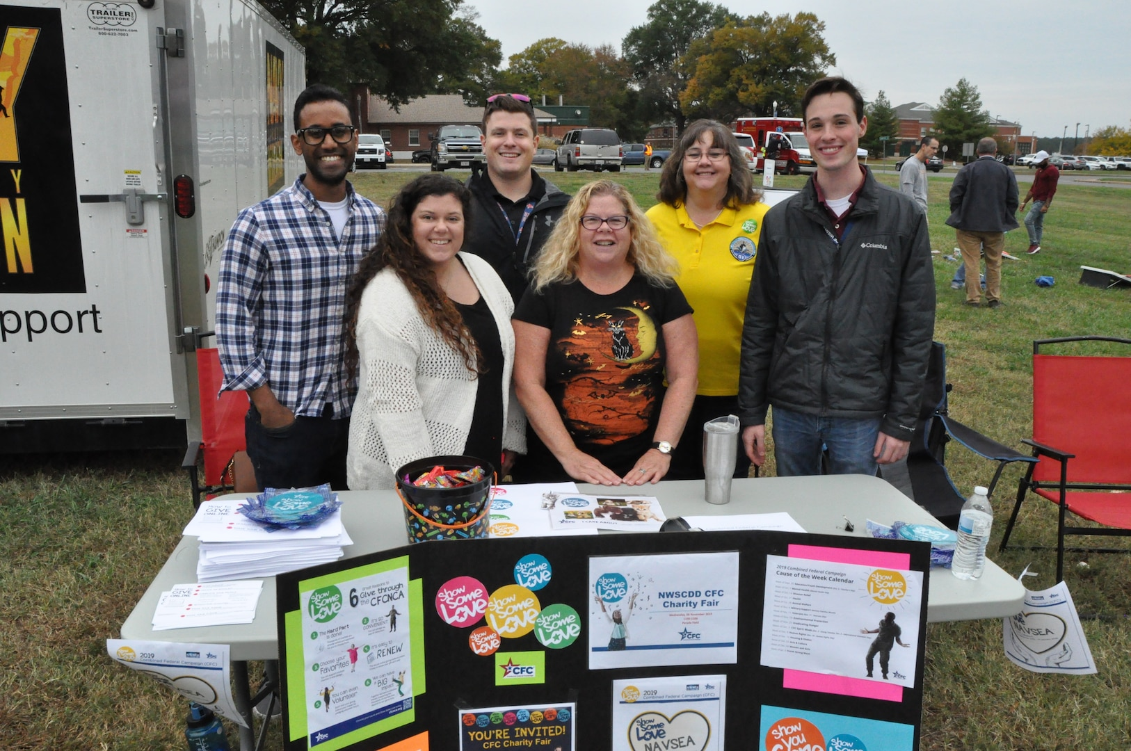 IMAGE: DAHLGREN, Va. (Oct. 30, 2019) – The Naval Surface Warfare Center Dahlgren Division (NSWCDD) Combined Federal Campaign team is pictured at the command picnic spreading the word about new features of the CFC campaign. Each week until the last day to give – Jan. 12, 2020 – highlights causes including environmental protection, eradicating hunger, human rights, and arts and culture. Back row left to right are Vijay Ahluwalia, Bryce Betz, and Joyce Clark. Front row left to right are Rebecca Storke, Katy Evans, and Kyle Duca. (U.S. Navy photo/Released)