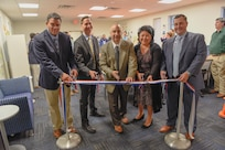From left: Matt Early, branch head for Information Technology Operations; Garth Jensen, director of innovation; Larry Tarasek, technical director; Anna Eshbaugh, branch head for Information Management Customer Service; and Mike Kirby, command information officer cut the ribbon to the new Rapid Innovation Center at Naval Surface Warfare Center Carderock Division on Oct. 29, 2019, in West Bethesda, Md. (U.S. Navy photo by Harry Friedman/Released)
