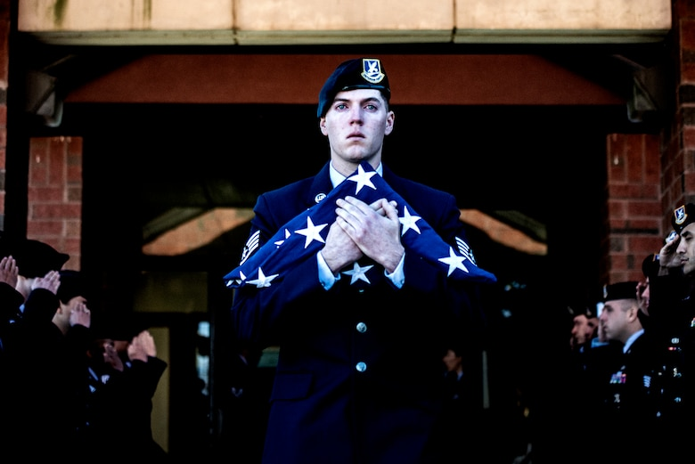 U.S. Air Force Staff Sgt. Alec Ducsay, 87th Security Forces military working dog handler, exits the McGuire Chapel as a final salute is rendered in honor of his MWD Robby during a memorial ceremony on Joint Base McGuire-Dix-Lakehurst, New Jersey, Nov. 1, 2019. Robby was born Jan. 9, 2009 and entered the Air Force on June 24, 2011. She served her country performing as a patrol explosive detector dog in Saudi Arabia, Kyrgyzstan and Kuwait.