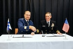Rear Adm. Marcus A. Hitchcock (right), U.S. Space Command plans and policy director, and Maj. Gen. Pasi Jokinen (left), commander of the Finnish Air Force, after signing a Memorandum of Understanding between the United States and Finland on Space Situational Awareness cooperation in Helsinki, Finland, Nov 4, 2019. The Memorandum of Understanding sets out the intention to exchange public space situational information between the United States and Finland. These agreements foster openness, predictability of space operations, and transparency for space domain awareness. (MoD of Finland photo by Finnish Air Force Public Affairs/Released)