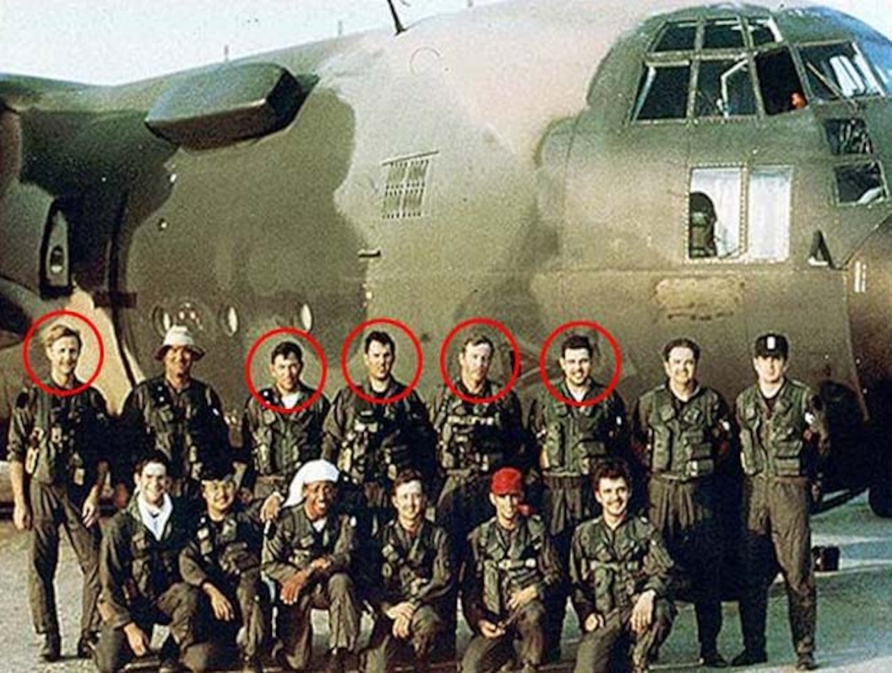 Men pose for photo in front of plane. Circles identify five men who were killed in an accident.