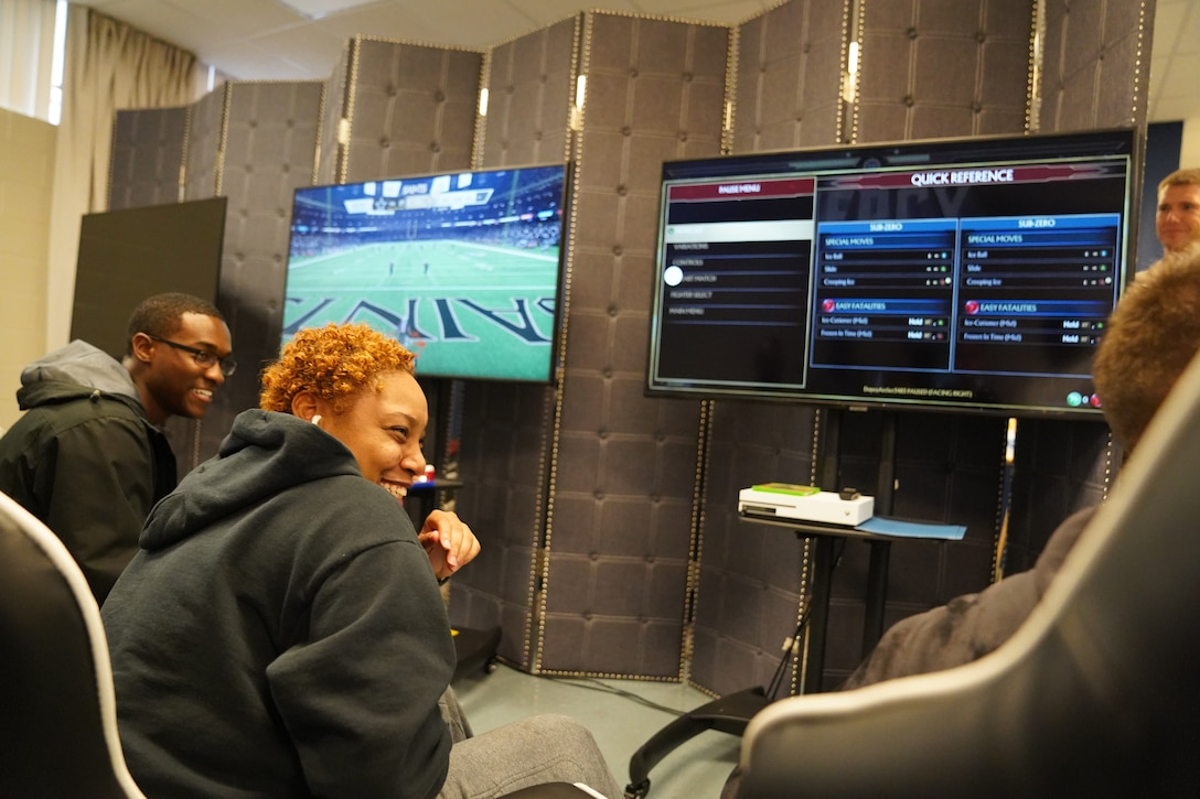 Keesler Airmen laugh during the opening of The Lighthouse inside the Larcher Chapel at Keesler Air Force Base, Mississippi, Nov. 1, 2019. The Lighthouse is a place dedicated to permanent party Airmen complete with gaming stations, massage chairs, a kitchen, and a music room. The idea of the lighthouse stemmed from a meeting Col. Heather Blackwell, 81st Training Wing commander, had with some of Keesler's dorm residents in August. (U.S Air Force photo by Airman 1st Class Spencer Tobler)