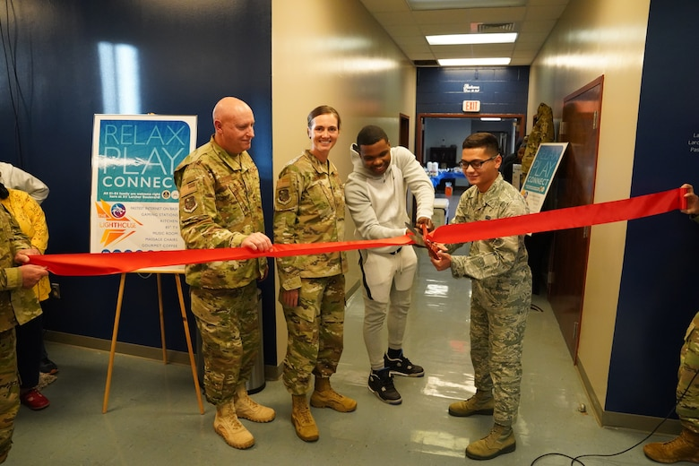 Keesler leadership and Airman's Council members cut the ribbon to the The Lighthouse inside the Larcher Chapel at Keesler Air Force Base, Mississippi, Nov. 1, 2019. The Lighthouse is a place dedicated to permanent party Airmen complete with gaming stations, massage chairs, a kitchen, and a music room. The idea of the lighthouse stemmed from a meeting Col. Heather Blackwell, 81st Training Wing commander, had with some of Keesler's dorm residents in August. (U.S Air Force photo by Airman Seth Haddix)