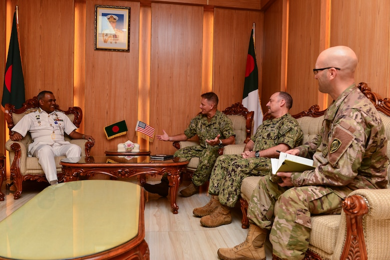 Chattogram, Bangladesh (Nov. 4, 2019) U.S. Navy Rear Adm. Joey Tynch, commander, Logistics Group Western Pacific, right, speaks with Rear Adm. M Abu Ashraf, Commander, Chattogram Naval Area, during an office call in support of Cooperation Afloat Readiness and Training (CARAT) Bangladesh 2019. This year marks the 25th iteration of CARAT, a multinational exercise designed to enhance U.S. and partner navies' abilities to operate together in response to traditional and non-traditional maritime security challenges in the Indo-Pacific region.