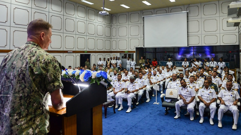 Chattogram, Bangladesh (Nov. 4, 2019) Rear Adm. Joey Tynch, commander, Logistics Group Western Pacific, provides his opening remarks during the opening ceremony for Cooperation Afloat Readiness and Training (CARAT) Bangladesh 2019. This year marks the 25th iteration of CARAT, a multinational exercise designed to enhance U.S. and partner navies' abilities to operate together in response to traditional and non-traditional maritime security challenges in the Indo-Pacific region.