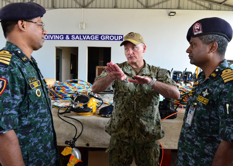 Chattogram, Bangladesh (Nov. 4, 2019) Rear Adm. Joey Tynch, commander, Logistics Group Western Pacific, speaks with senior delegates of the Special Warfare Diving and Salvage (SWADS) community as part of Cooperation Afloat Readiness and Training (CARAT) Bangladesh 2019. This year marks the 25th iteration of CARAT, a multinational exercise designed to enhance U.S. and partner navies' abilities to operate together in response to traditional and non-traditional maritime security challenges in the Indo-Pacific region.