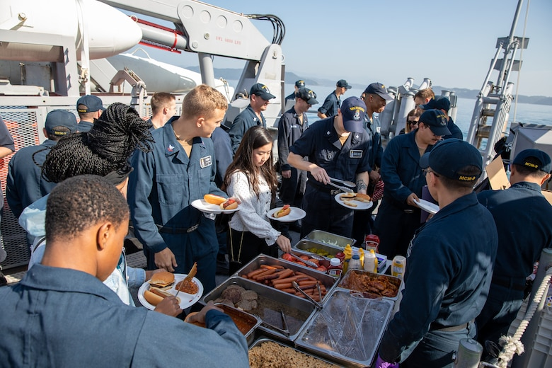 191101-N-AD347-0063 SASEBO, Japan (November 01, 2019) The Pioneer crew, family and friends of Avenger-class mine countermeasures ship USS Pioneer (MCM 9) enjoyed burgers and hot dogs during the 'Splinter Beach Picnic' on the fantail of the ship. Pioneer, part of Mine Countermeasures Squadron 7, is operating in the 7th Fleet area of operations to enhance interoperability with partners and serve as a ready-response platform for contingency operations.