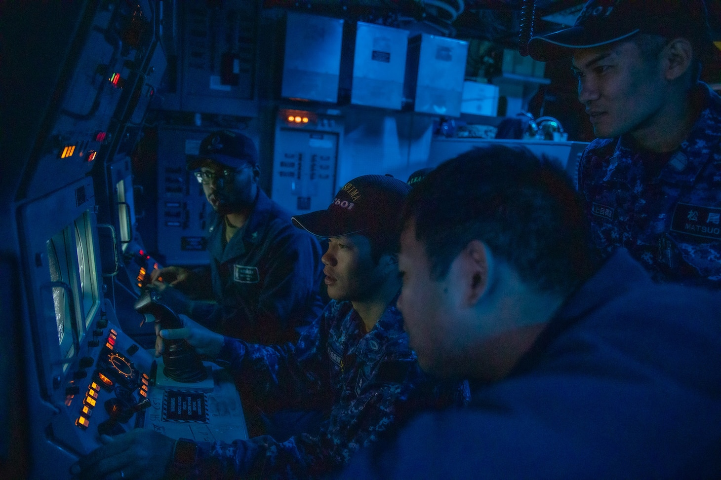 191101-N-AD347-0141 SASEBO, Japan (November 01, 2019) Japanese Maritime Self-Defense Force sailors from Hirashima-class Mine Countermeasures ship, Hirashima MSC 601 use a simulator program to practice driving a mine neutralization vehicle in order to hone their skills and mine hunting aboard Avenger-class mine countermeasures ship USS Pioneer (MCM 9). Pioneer, part of Mine Countermeasures Squadron 7, is operating in the 7th Fleet area of operations to enhance interoperability with partners and serve as a ready-response platform for contingency operations.