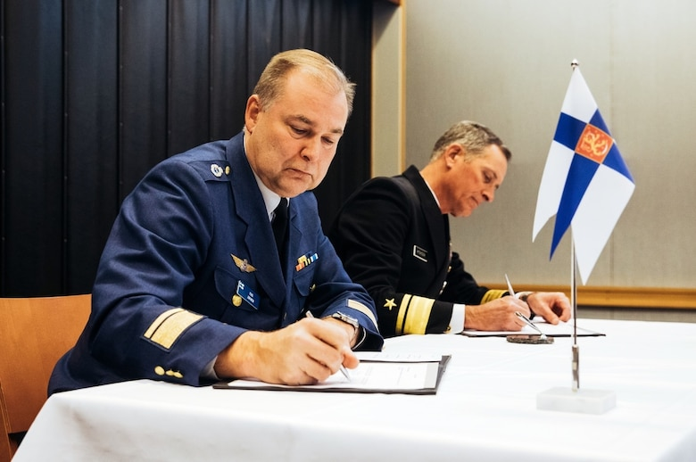 Rear Adm. Marcus A. Hitchcock, U.S. Space Command plans and policy director, and Maj. Gen. Pasi Jokinen, commander of the Finnish Air Force, sign a Memorandum of Understanding between the United States and Finland on Space Situational Awareness cooperation in Helsinki, Finland, Nov 4, 2019. As a key international partner, the Finnish Air Force develops Space Situational Awareness as an integrated part of Finnish Defence Forces' joint situational awareness. (MoD of Finland photo by Finnish Air Force Public Affairs/Released)