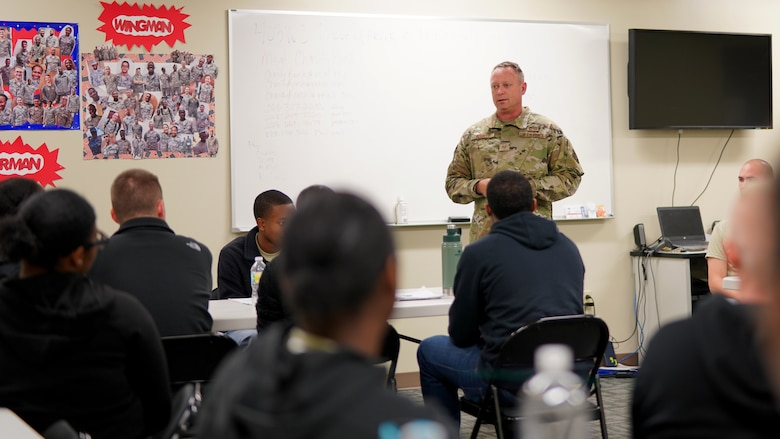 Senior Master Sgt. Robert Elliot, military training instructor recruiter for the 433rd Training Squadron at Lackland Air Force Base, Texas, speaks to trainees from the 403rd Wing's Development and Training Flight at Keesler Air Force Base, Miss., Nov. 3, 2019. Here for recruiting purposes, Elliot took time out of his day to answer any questions about basic military training and MTI opportunities. (U.S. Air Force photo by Senior Airman Kristen Pittman).