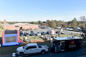 Families and members of the North Carolina Air National Guard mill around various stations during a Fall Festival put together by the Junior Enlisted Council (JEC) at the North Carolina Air National Guard (NCANG) Base, Charlotte Douglas International Airport, Nov. 2, 2019. The Fall Festival is a first-time event for the JEC and NCANG that is hoped to be held for years to come.