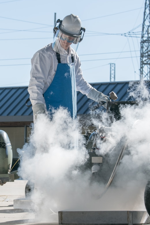 Airman 1st Class Justin Jett, fuels distribution operator, 436th Logistics Readiness Squadron, fills transfer carts with liquid oxygen, Nov. 4, 2019, at Dover Air Force Base, Del. The liquid oxygen will be loaded onto aircraft, where it is converted back to a breathable gaseous form for the aircrews. (U.S. Air Force photo by Mauricio Campino)