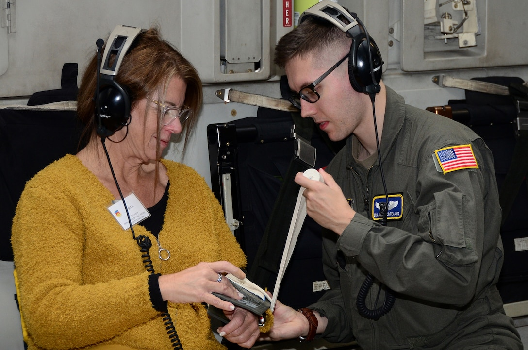 Senior Airman Devin Copeland, 445th Aeromedical Evacuation Squadron, puts a splint on volunteer Rita Cyr, CEO of Ronald McDonald House Charities Dayton, during a hands-on AES demonstration on board a 445th Airlift Wing C-17 Globemaster III during a civic leader tour flight to Colorado Springs Oct. 9, 2019. Nineteen Greater Dayton area civic leaders participated in a civic leader tour hosted by the 445th Airlift Wing Oct. 9-10 at both Peterson Air Force Base and the Air Force Academy in Colorado Springs, Colorado.