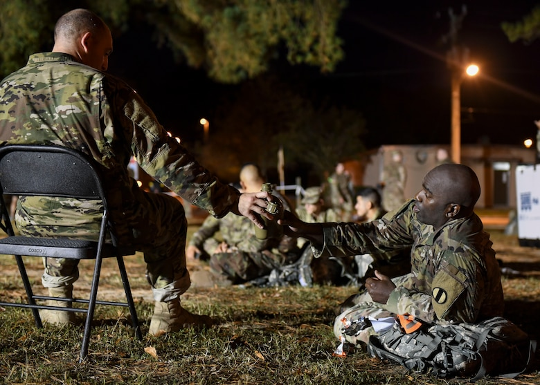 U.S. Army Soldiers share water after completing the Norwegian Foot March at Joint Base Langley-Eustis, Virginia, Oct. 30, 2019.