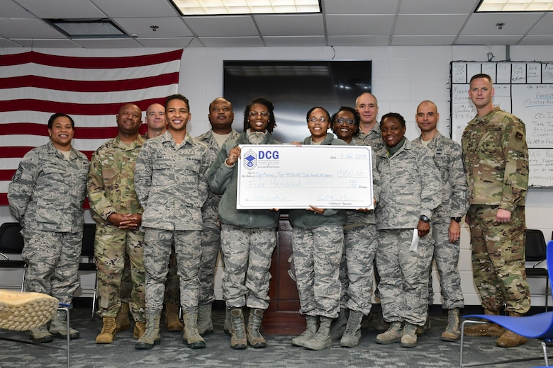 The Dobbins Chief Group Scholarship winners pose with the DCG during a ceremony held at Dobbins Air Reserve Base, Ga. on Nov. 4, 2019. Each winner received a check for $500 to be used towards school expenses. (U.S. Air Force photo/Tech. Sgt. Andrew Park)