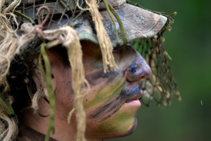 An Army Sniper School graduate prepares for a final challenge .