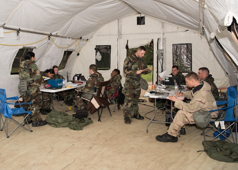 Contracting administrators with the 509th Contracting Squadron process contracts during a mock deployment exercise on Oct. 9, 2019, at Whiteman Air Force Base, Missouri. The Airmen split into two separate teams throughout the exercise, testing their skills and allowing them to compete with each other to build morale and ensure readiness. (U.S. Air Force photo by Airman 1st Class Parker J. McCauley)