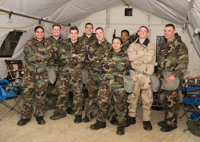 "Team ""Scott's tots"", made up of 509th Contracting Squadron Airmen, stands for a photo during a mock deployment exercise, Oct. 9, 2019, at Whiteman Air Force Base, Missouri. The team competed with the 'DeceptiCONS', another 509th CONS team, as regional contracting offices throughout the notional mobilization to Mogadishu, Somalia. (U.S. Air Force photo by Airman 1st Class Parker J. McCauley)"