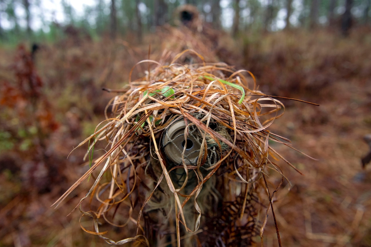 A view of a sniper's weapon looking down the barrel.