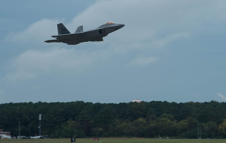 A U.S. Air Force F-22 Raptor takes off at Joint Base Langley-Eustis, Virginia, Oct. 31, 2019. The F-22 was involved in adversary air training with T-38A Talons. (U.S. Air Force photo by Airman 1st Class Sarah Dowe)