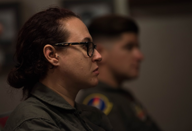 Vivienne Machi, Defense Daily reporter, listens to a pilots' briefing at Joint Base Langley-Eustis, Virginia, Oct. 31, 2019. Machi completed the required training needed to ride in a U.S. Air Force T-38A Talon during adversary air training. (U.S. Air Force photo by Airman 1st Class Sarah Dowe)
