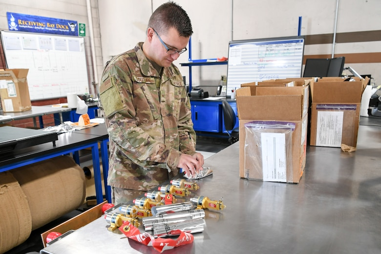 Senior Airman Alec Couture, munitions inspector with the 649th Munitions Squadron, inspects NASA assets on recently acquired electrostatic discharge workstations. The squadron recently purchased the workstations with Air Force Material Command squadron innovation funds, which has improved efficiency and safety of incoming and outgoing munitions inspections.