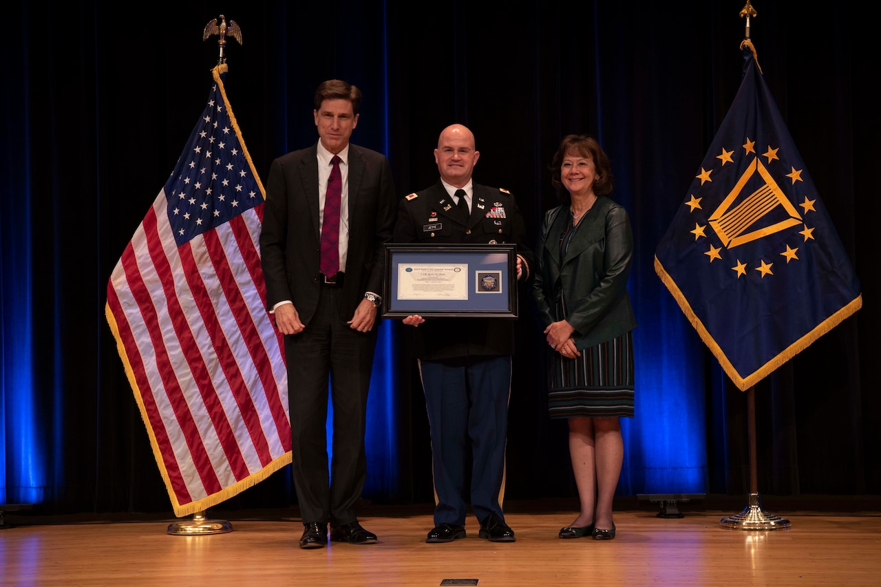 Army Col. Kyle F. Jette receives an award.
